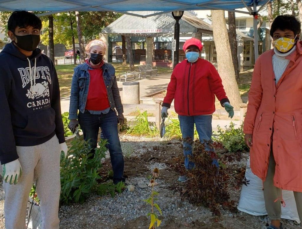 Volunteers at the St James Town pollinator garden